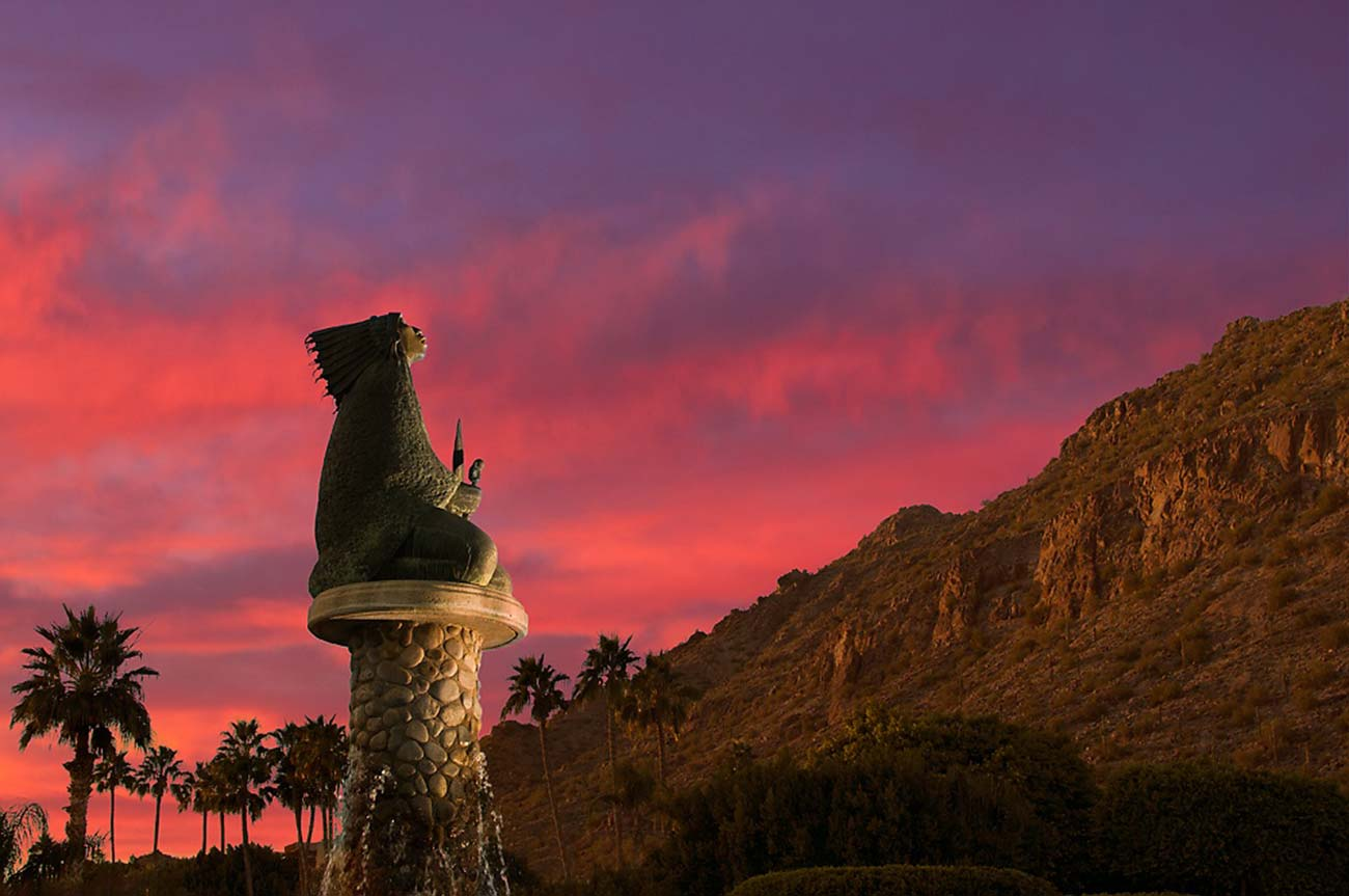 The Phoenician courtyard statue during sunset
