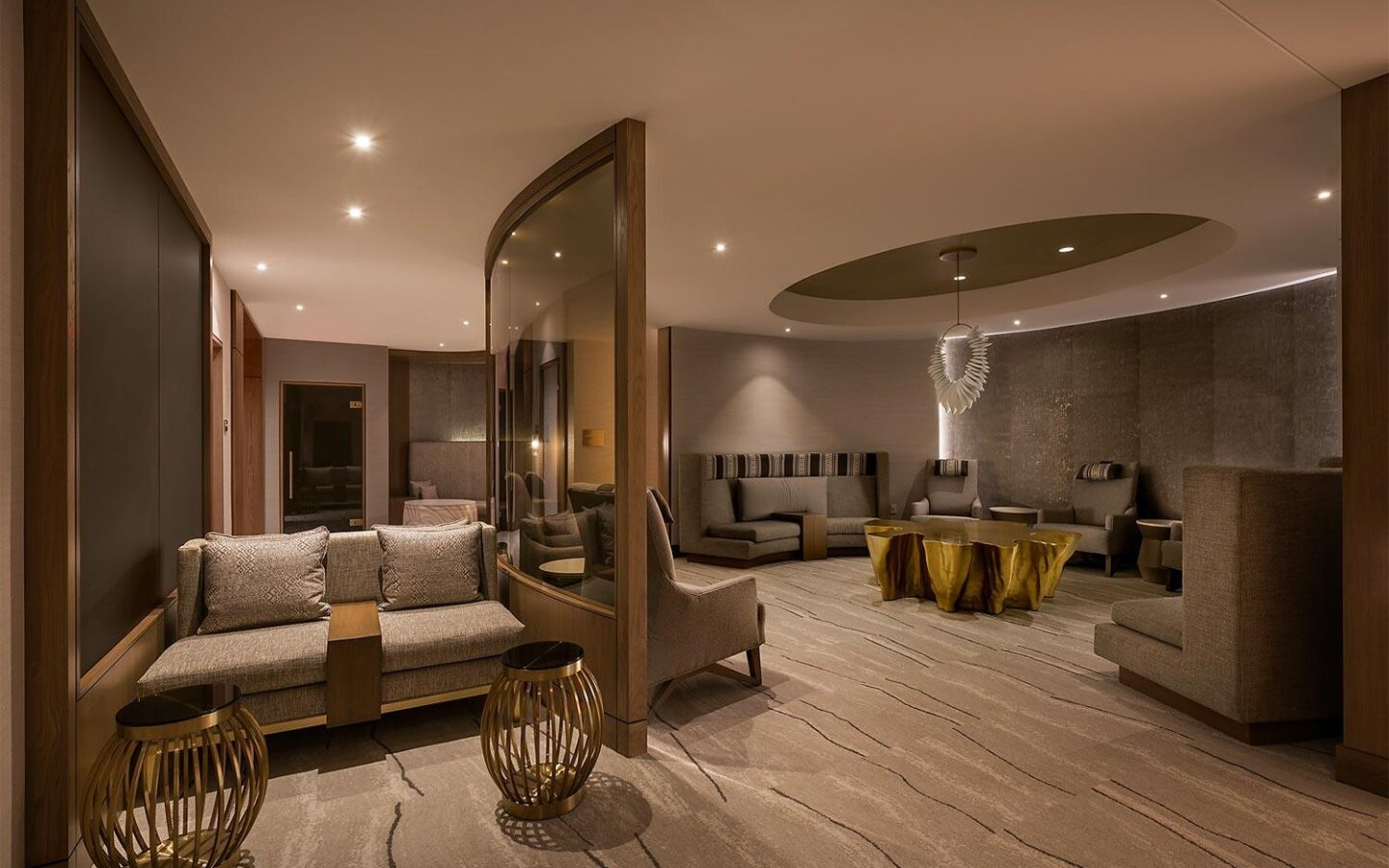 a luxury spa lounge area with comfortable seating and dim lighting