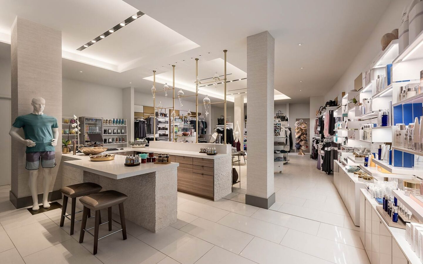 a brightly lit luxury spa boutique store with shelves of beauty products and gifts