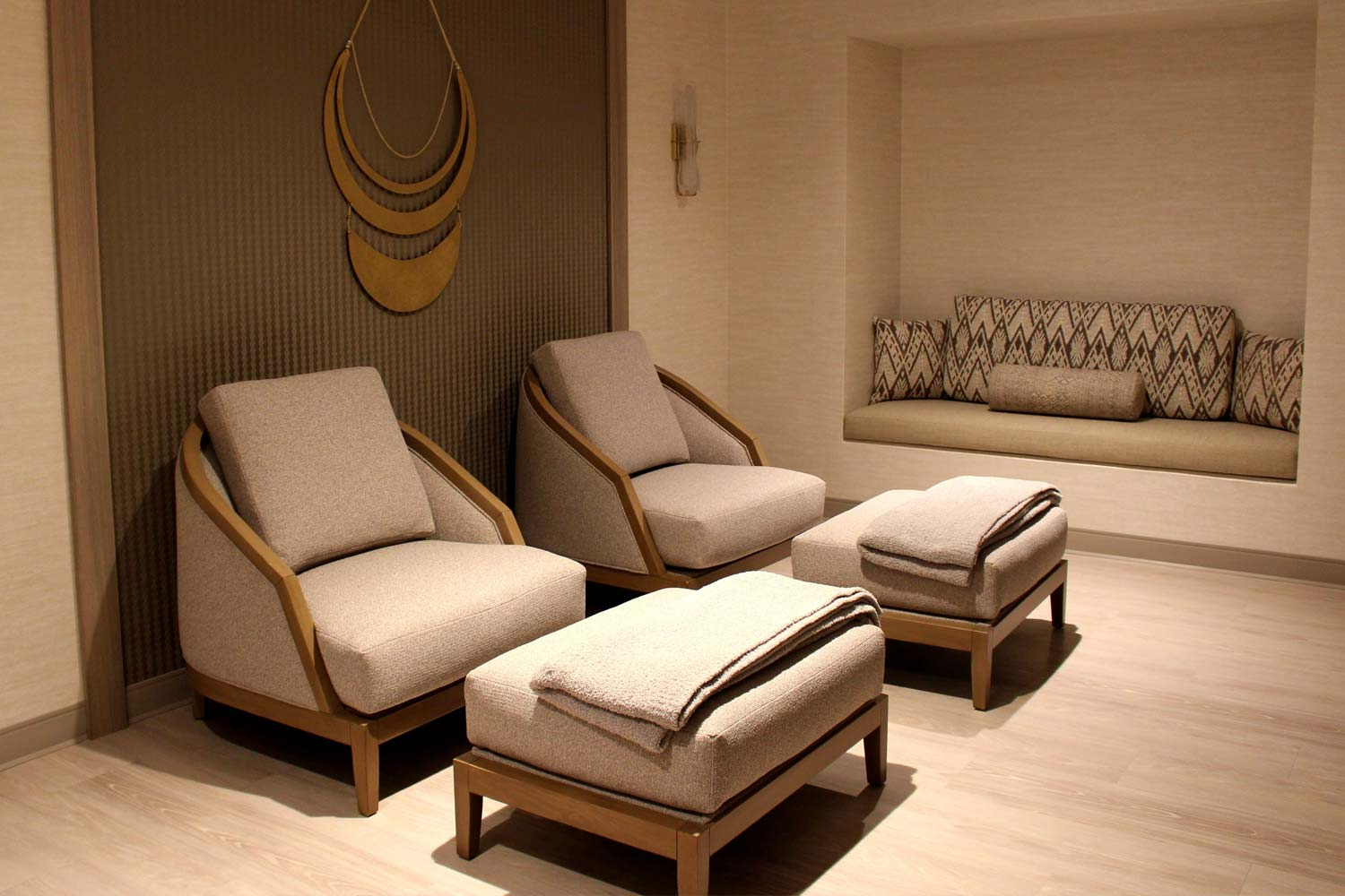 two comfortable chairs with foot-stools in the tranquility spa suite