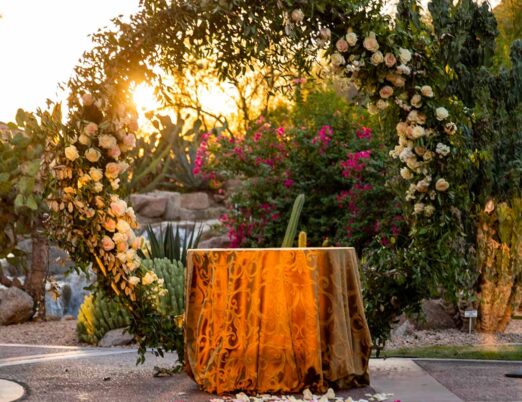 circle table under circle wedding arch set for wedding ceremony