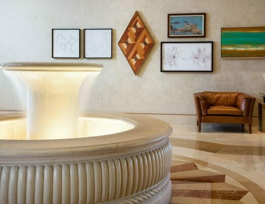 fountain in lobby with seating