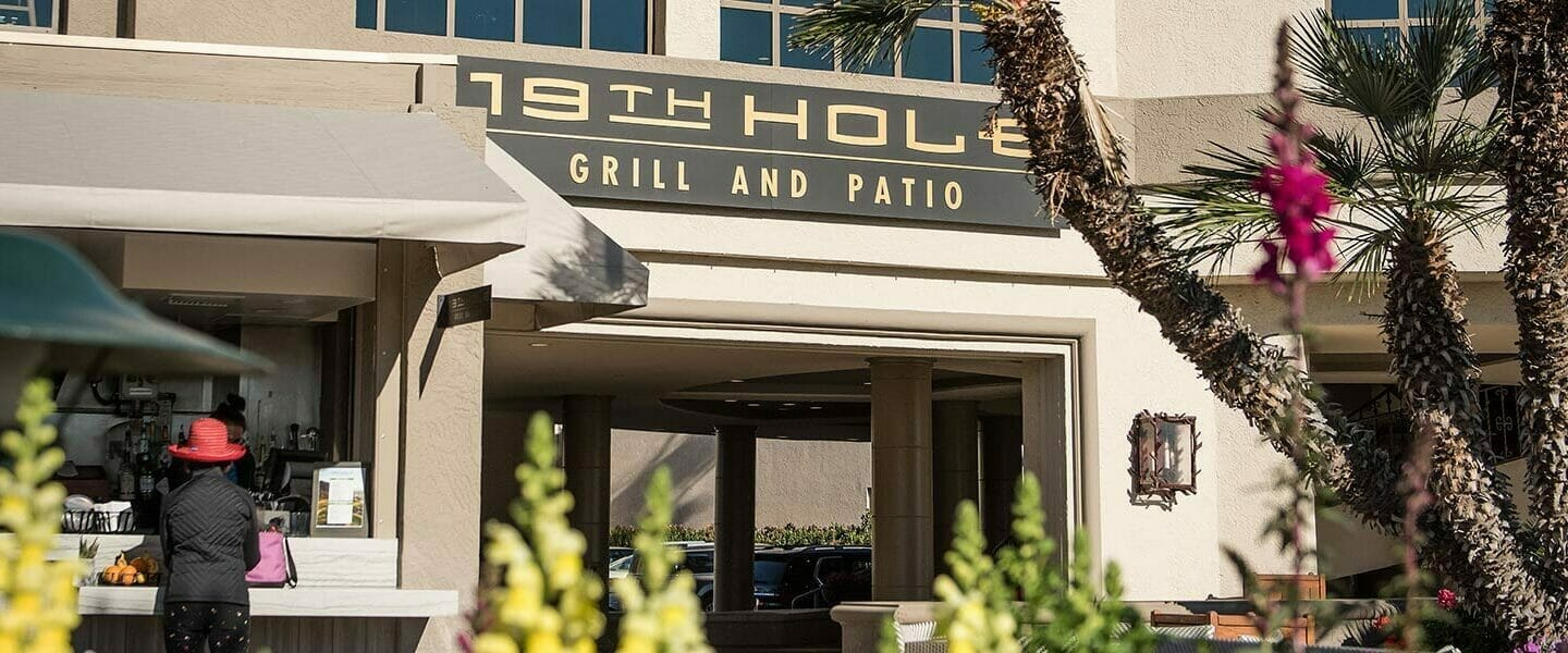 19th hole grill and patio sign and entrance
