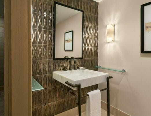 vanity with marble sink in guest bathroom