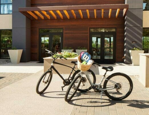 entrance to The Phoenician Athletic Club with two bicycles outside