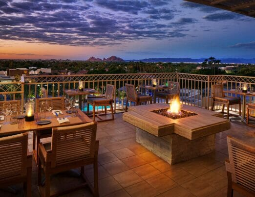 JS Steakhouse outdoor patio with fire table at dusk