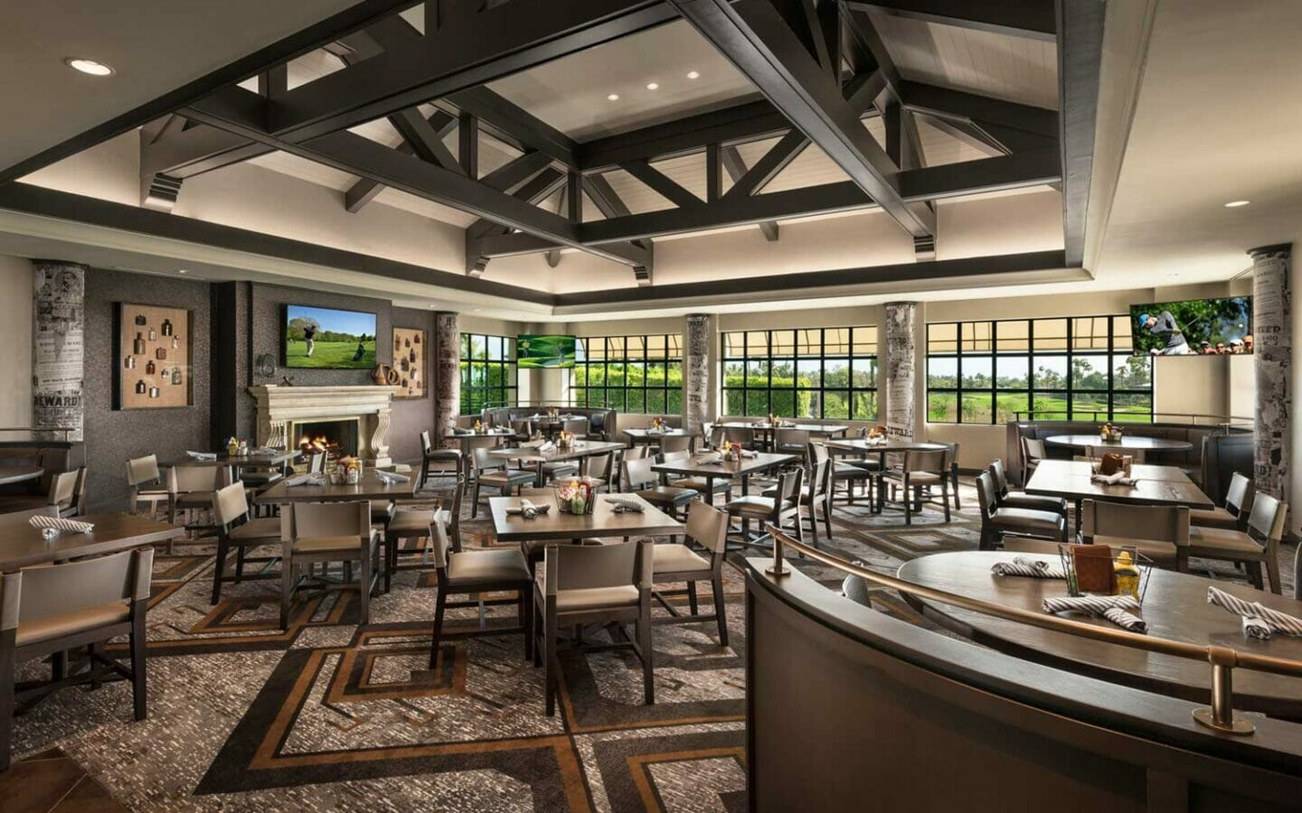 a tavern dining room with windows overlooking a golf course at The Phoenician