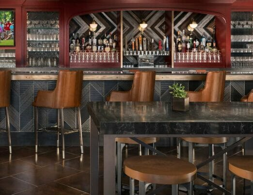 the Phoenician Tavern with high chairs lining the bar