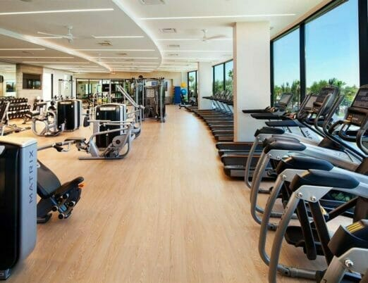 The Phoenician Athletic Club Fitness Center with exercise bikes and weight machines