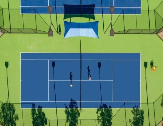 two tennis plays on the outdoor court at The Phoenician